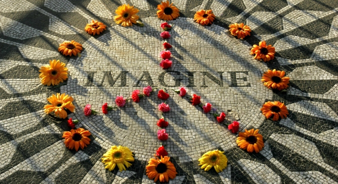"A makeshift peace sign of flowers lies on top John Lennon's ""Strawberry Fields"" memorial  in New York's Central Park,   Wednesday Dec. 7, 2005. The memorial is near the Dakota building where Lennon, a former member of the Beatles, lived with his wife Yoko Ono and son Sean when he was murdered outside the building.  Thursday is the 25th anniversary of his death.  (AP Photo/Bebeto Matthews)"